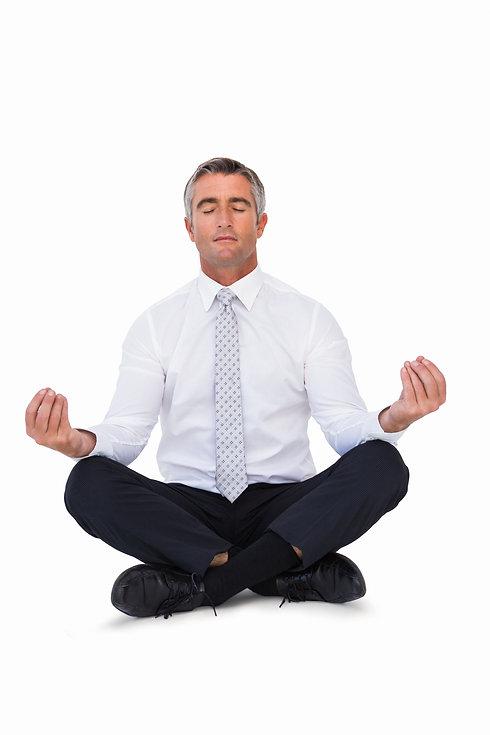 Zen businessman meditating in lotus pose