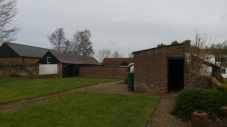 A garden shed in a well-kept garden