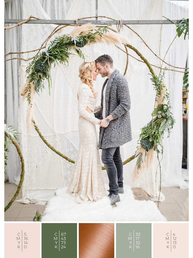 A ceremony backdrop for a boho glass house wedding combined with a color scheme of green, blush and copper.