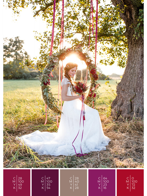 This wedding dress for a garden wedding fits perfectly to a colorful boho wedding style in shades of red, pink and puprle.