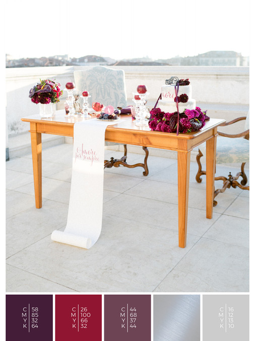 "This wedding table decoration of the wedding mood board ""Venice Rooftop"" has a color scheme palette in shades of violet and red."