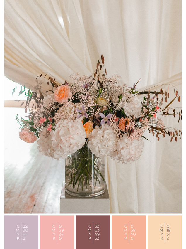 """The flowers of the wedding mood board """"Precious Petals"""" create a color scheme palette in shades of violet and coral."""