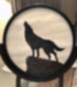 Wolf howlig at moon.jpg