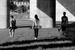 pov of  3 skaters walking while holding skateboards