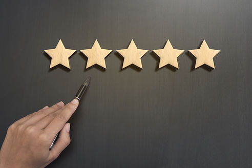 Business hand select five star rating on
