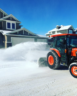 Kubota L6060 blowing snow