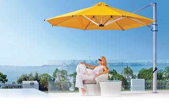 relaxing_woman_under_yellow_cantilever_umbrella.jpg