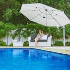 cantilever_umbrella_shading_woman_poolside.jpg