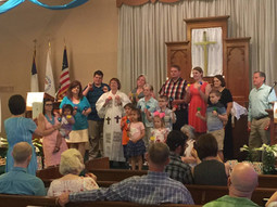 Bell choir performing during service.