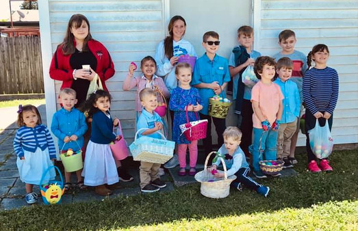 Children holding Easter baskets before an Easter egg hunt