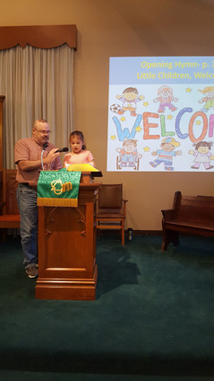 Children participate in worship service on Rally Day by reading from the lectern