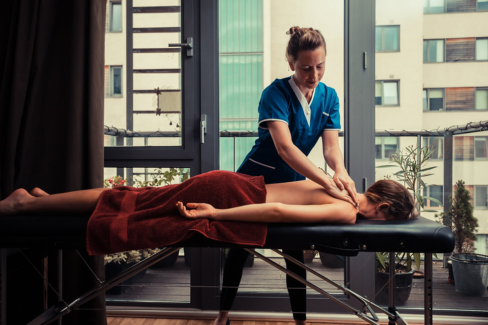 A massage therapist is treating a female