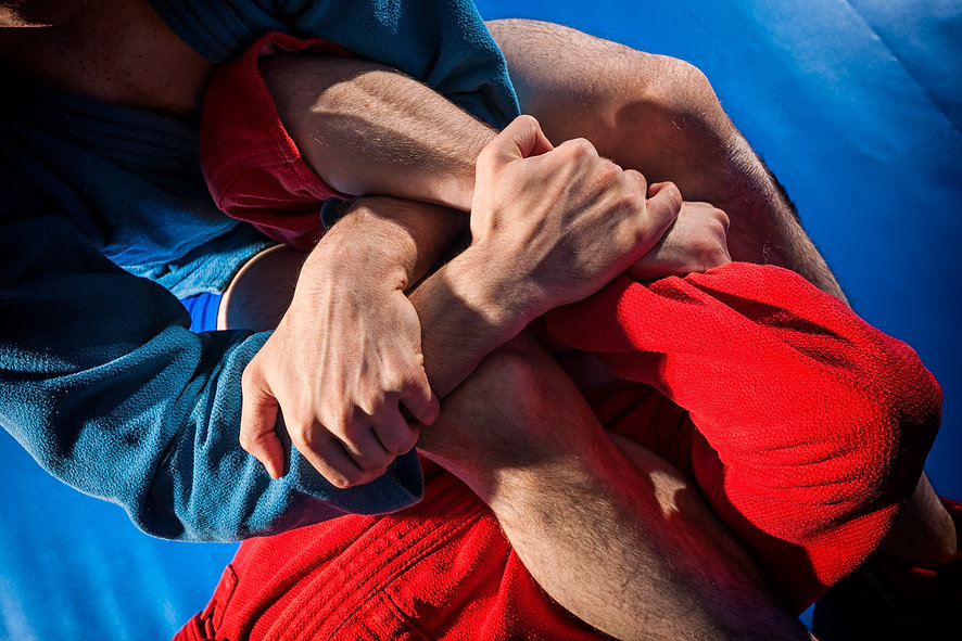 Close-up two wrestlers of grappling and