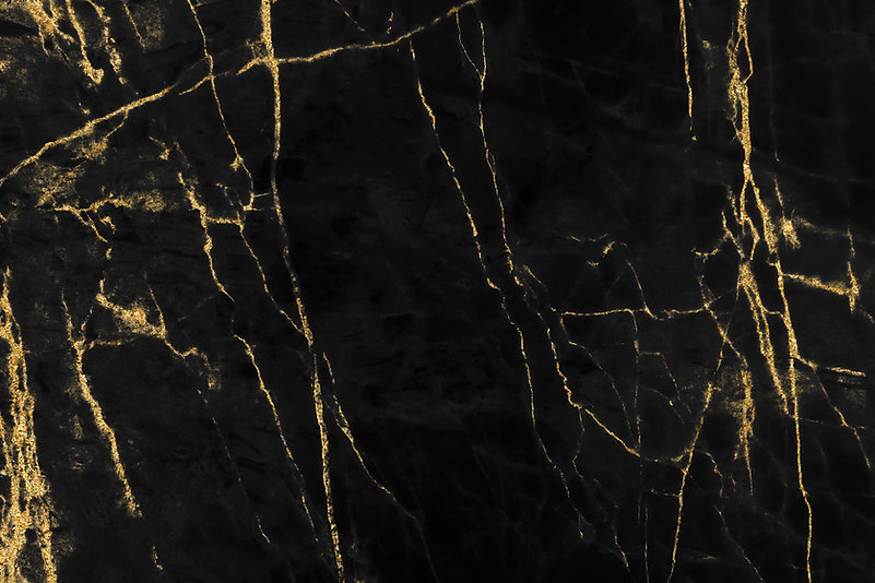 Gold marbling texture on black backgroun