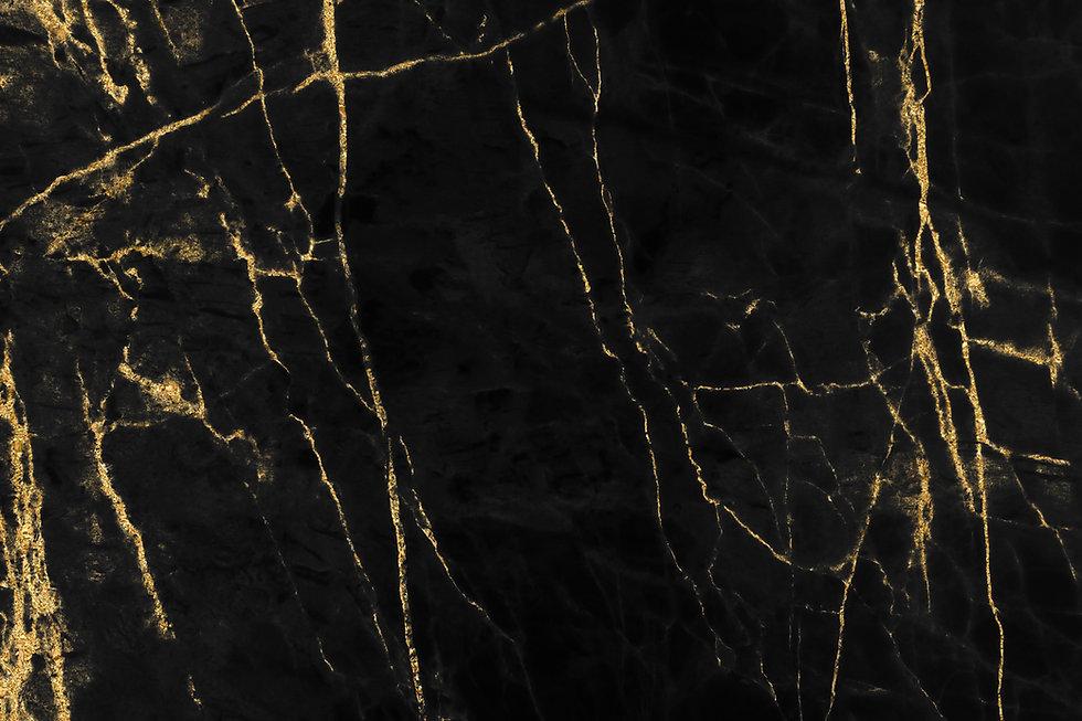 Gold marbling texture on black backgroun