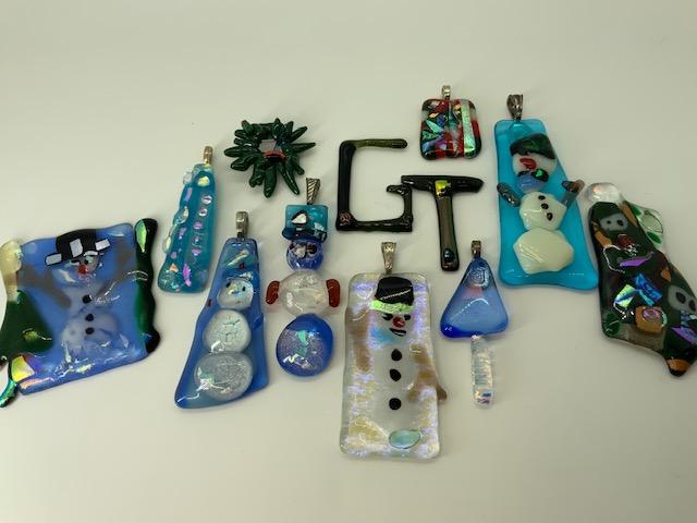 Intricate Glass Tiki Jewelry Art