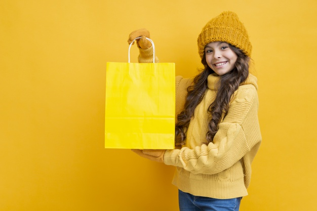 cute-girl-with-yellow-shopping-bag_23-21