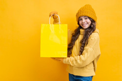 cute-girl-with-yellow-shopping-bag_23-21