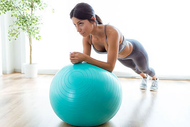 beautiful-young-woman-doing-pilate-exerc