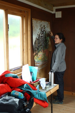 Gayle Rogers drawing in hut