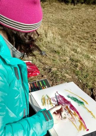 Gayle Rogers working en plein air at the Pen y Cymoedd Wind Energy Site