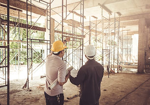 two business man construction site engin