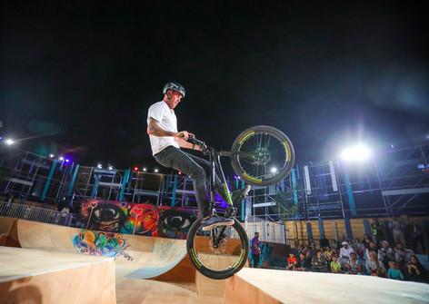 BMXer doing tricks at outdoor event