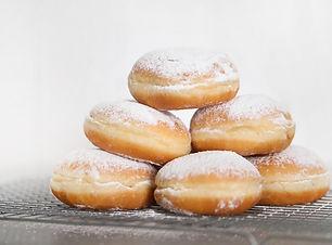 food-freshly-baked-doughnuts-table (1).j
