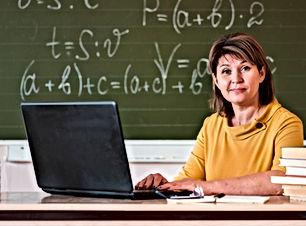 female-teacher-with-laptop-working.jpg