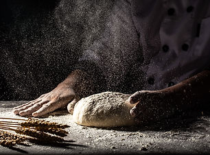 white-flour-flying-into-air-as-pastry-ch