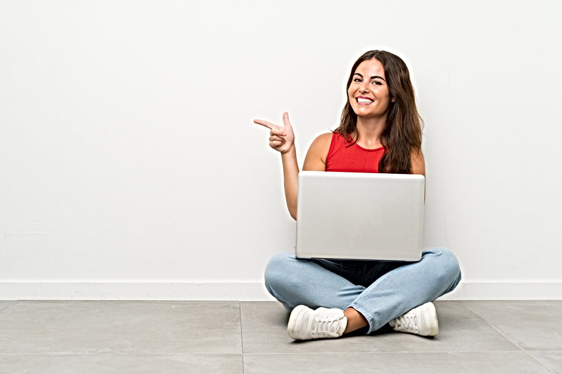 young-woman-with-laptop-sitting-floor-po