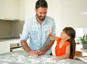 joyful-dad-daughter-having-fun-while-kne
