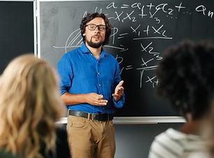 caucasian-man-teacher-school-blackboard-
