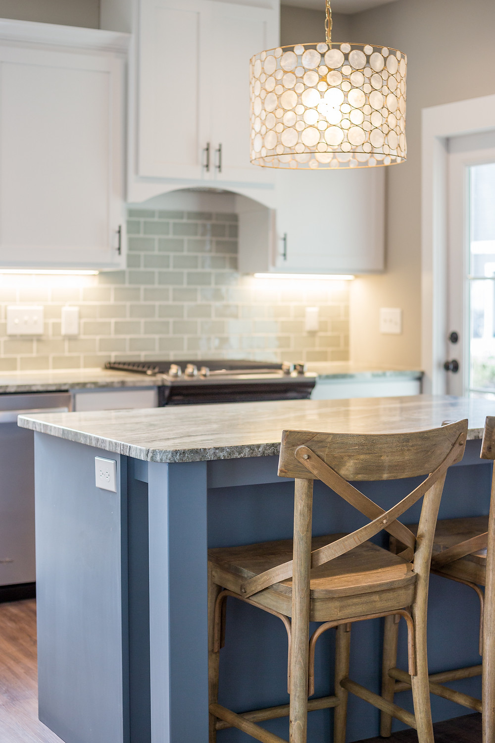 Wooden Kitchen barstool at eat in kitchen. Staged kitchen with cleared countertops