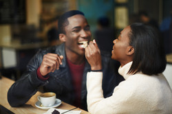 Beautiful dark skinned couple in love having a great time together man and woman enjoying each other
