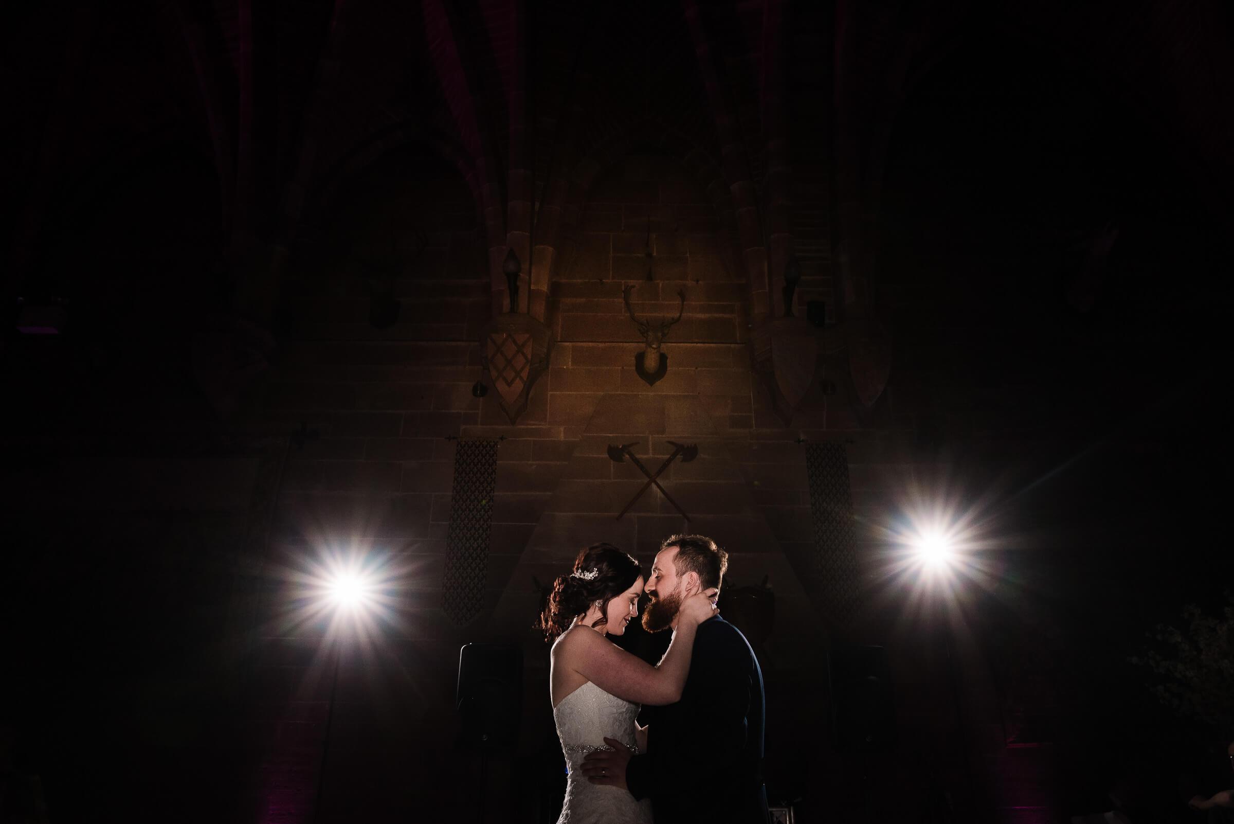 groom kissing bride during dance