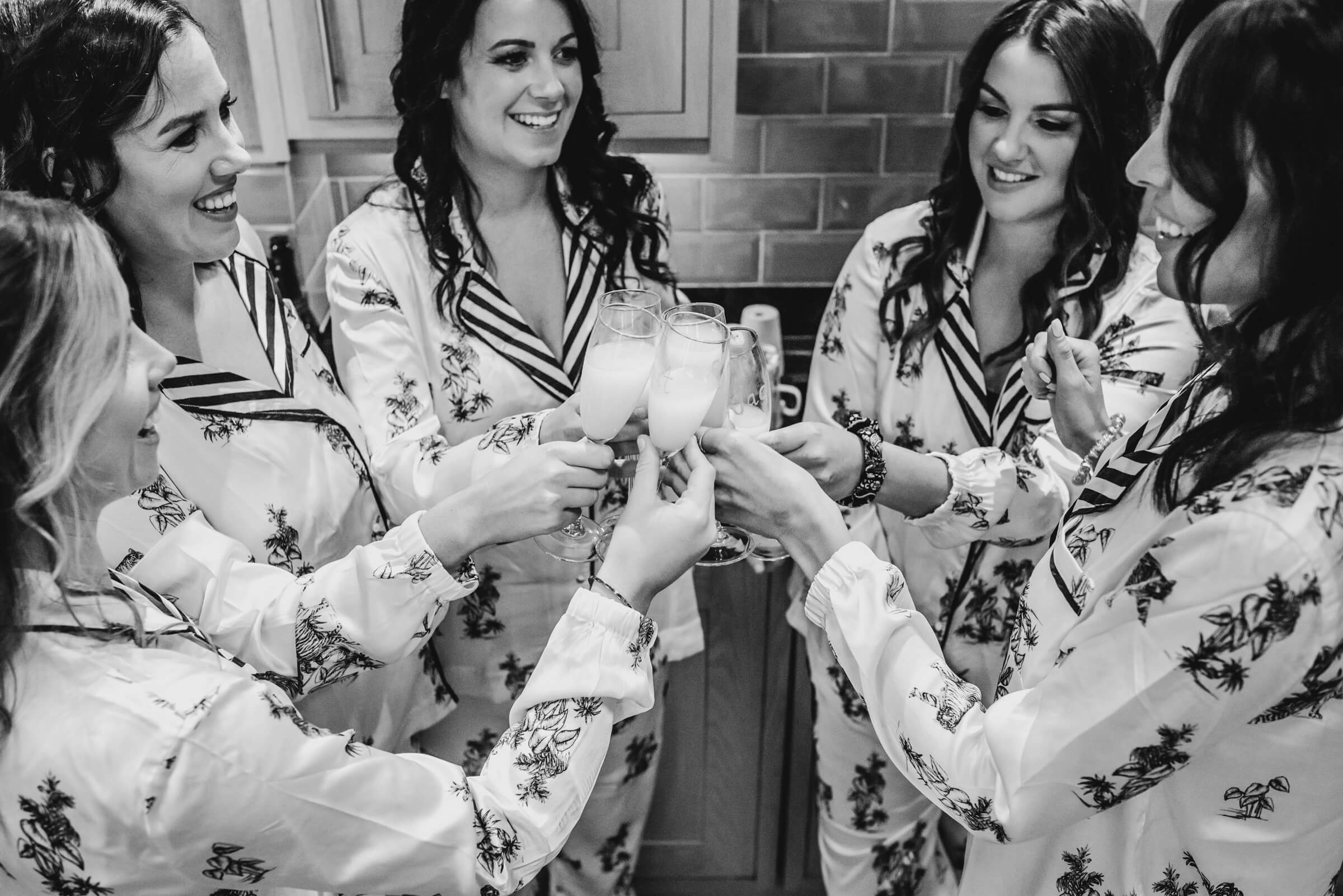 bridesmaids toasting with champagne