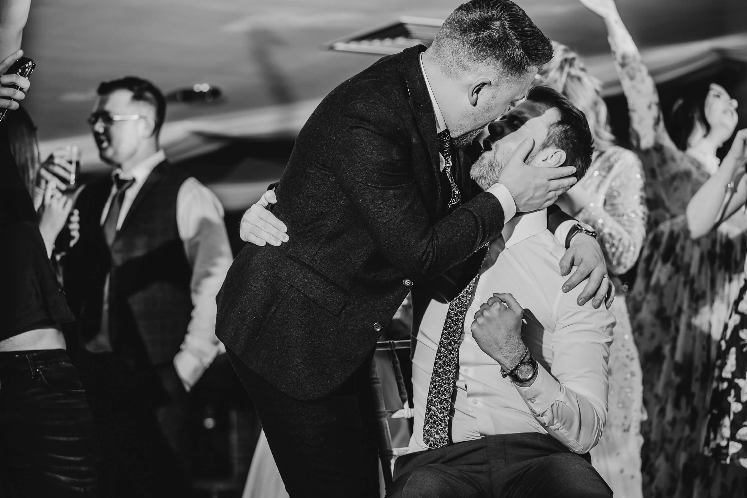 Groom and friend having fun on dance floor