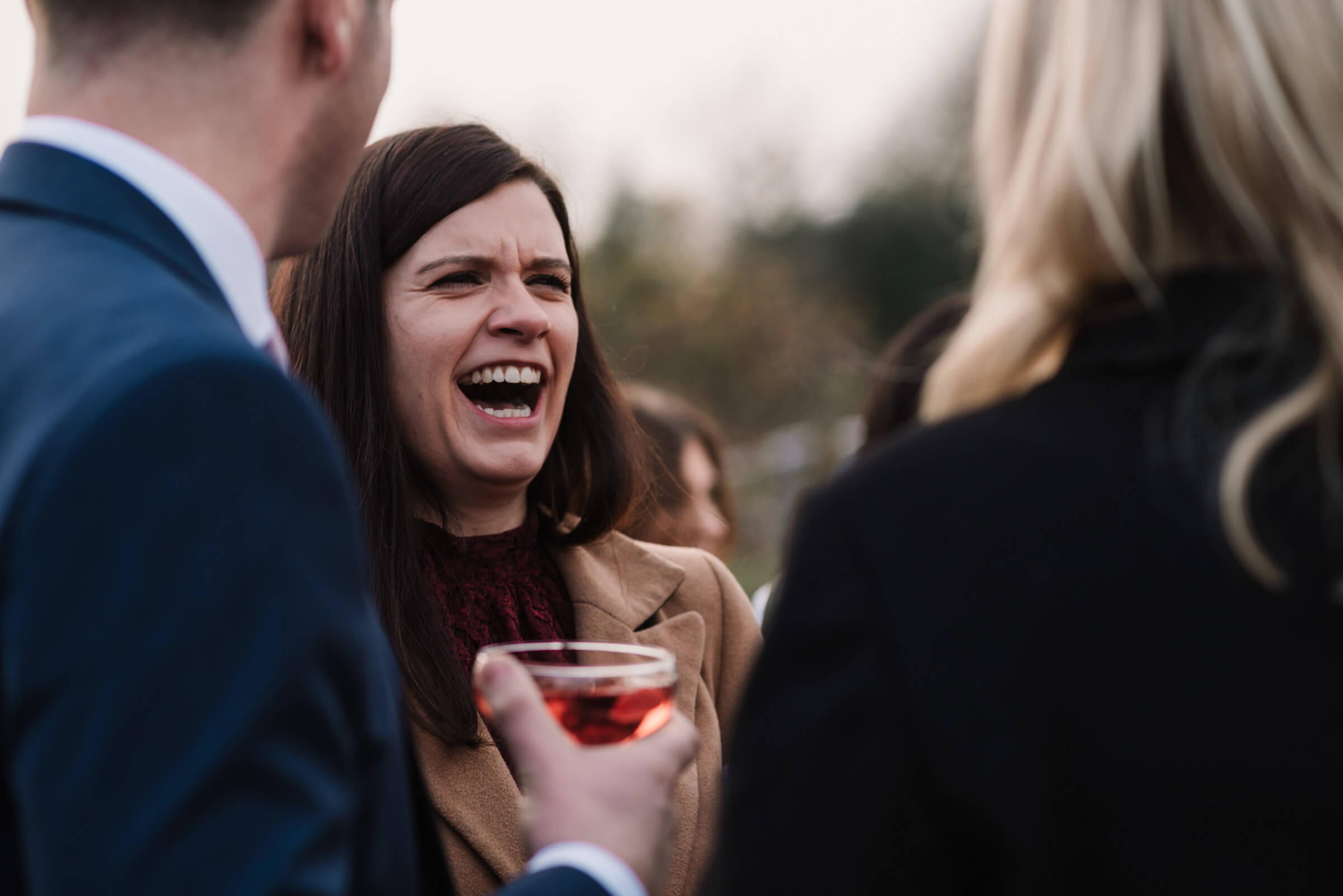 guests laughing during reception