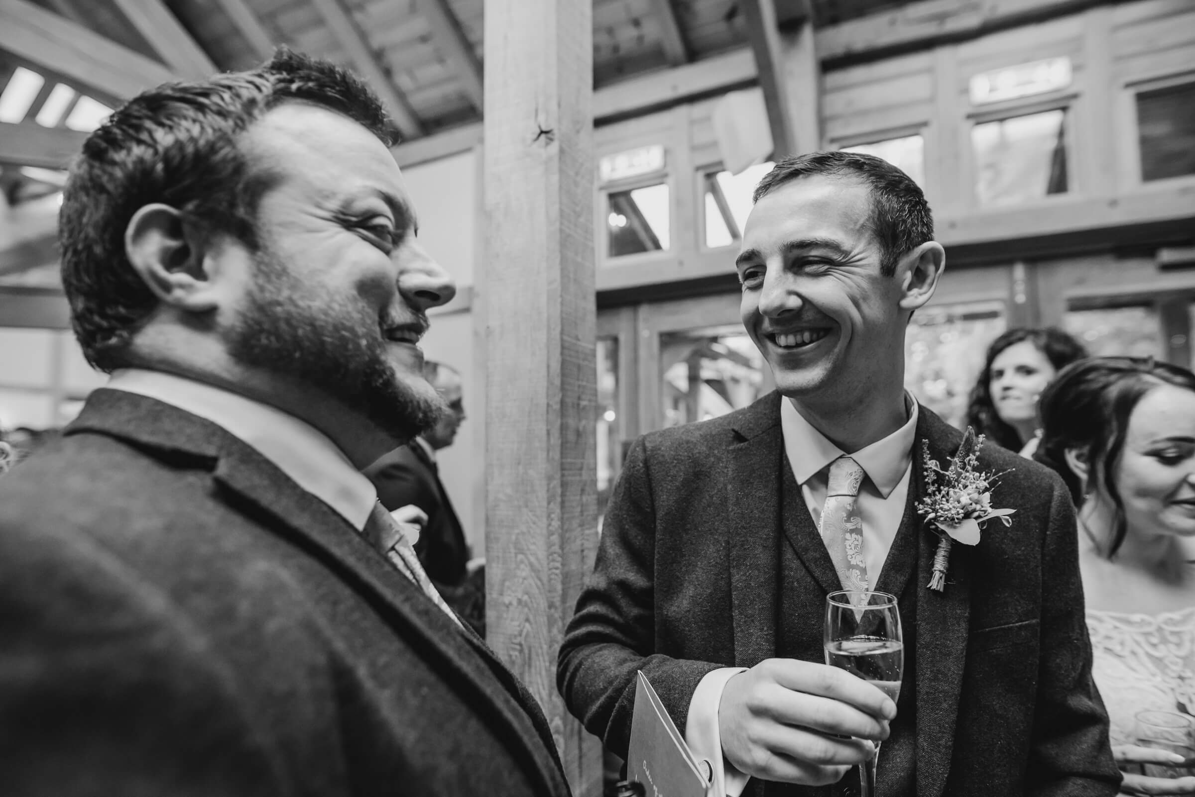 best man laughing with groomsman