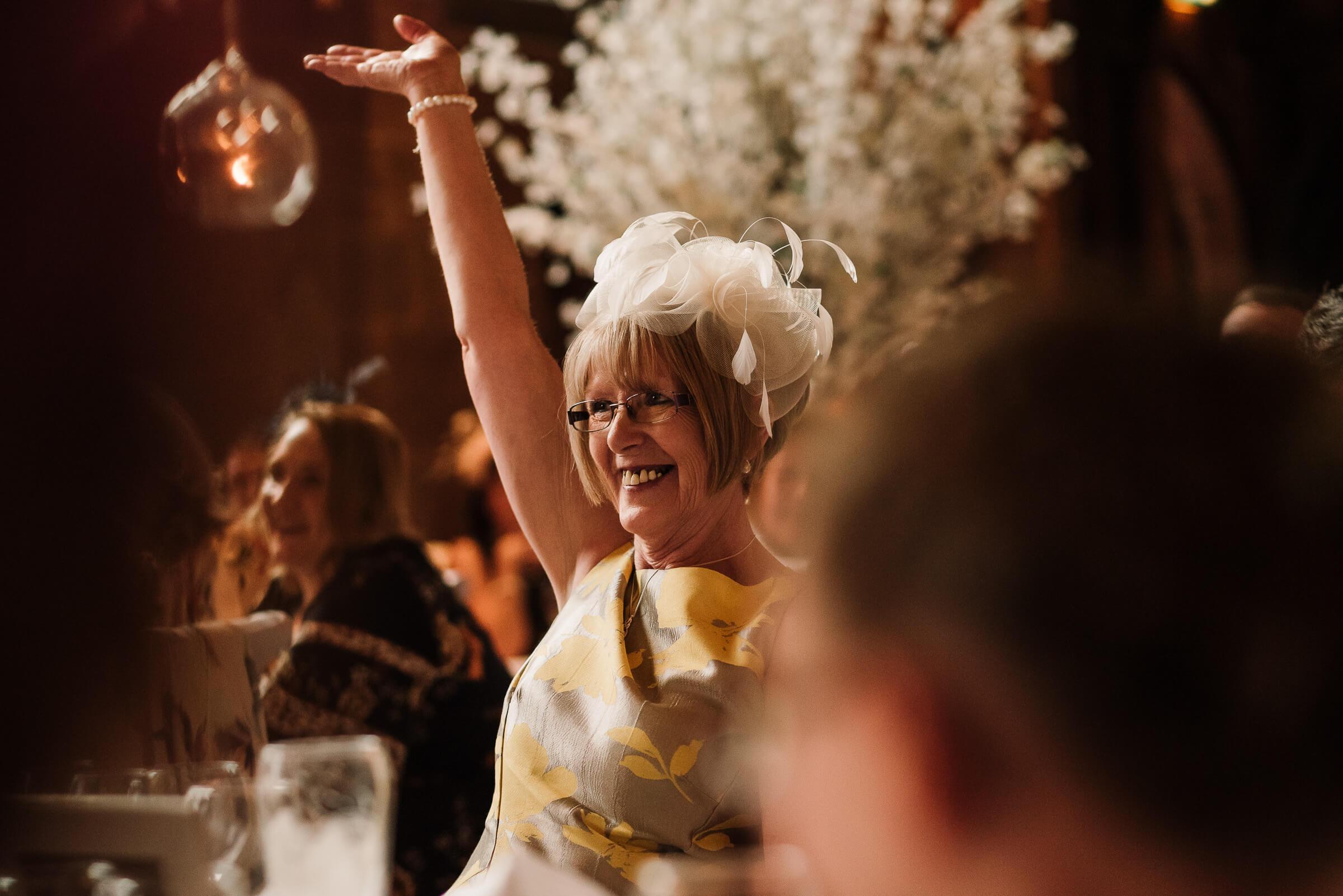 mother of bride cheering during speech