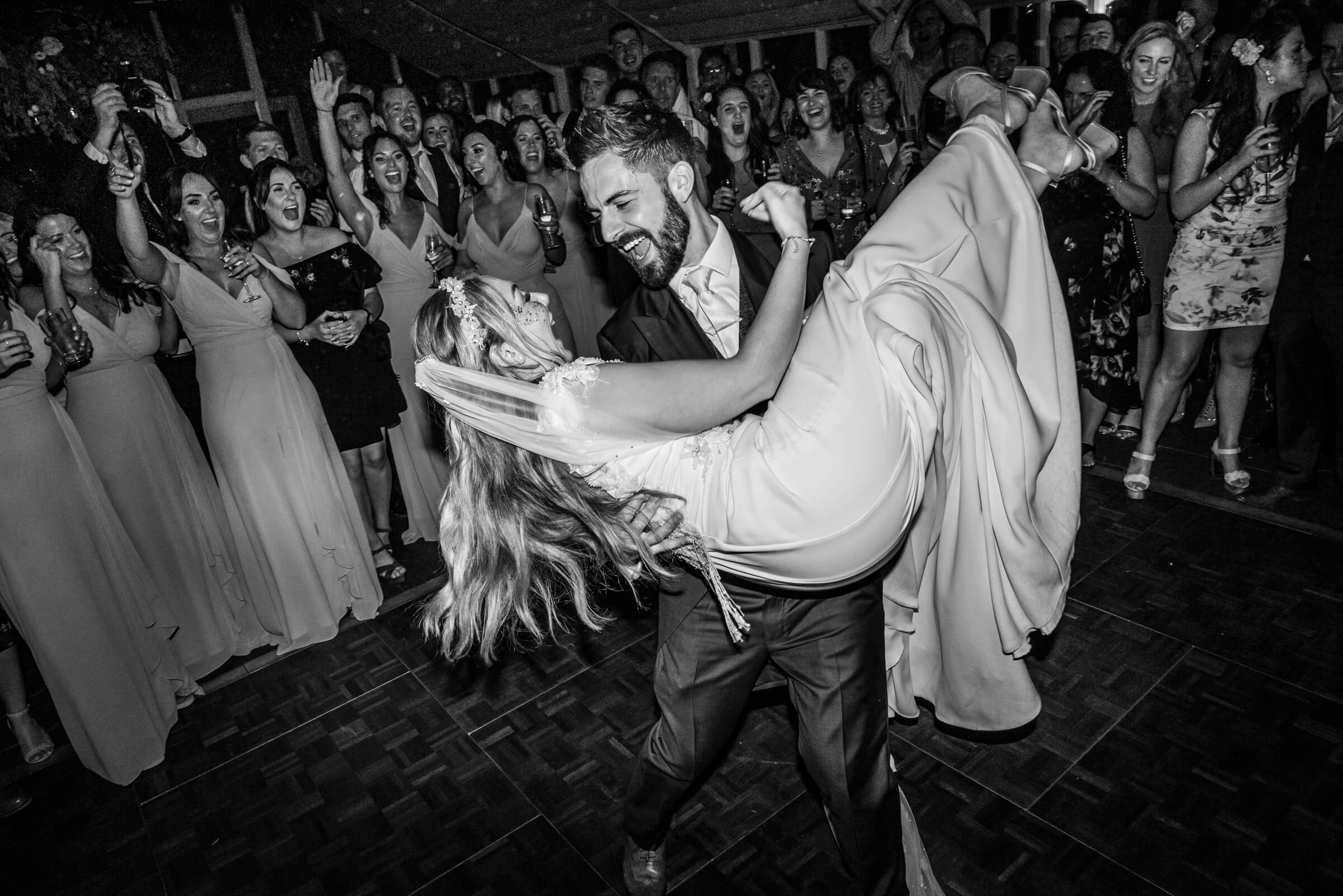 groom picking up bride during first dance