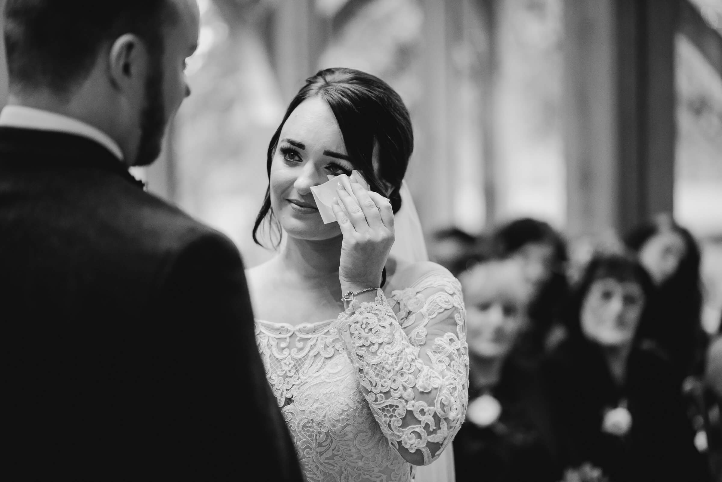 bride shedding a tear during vows