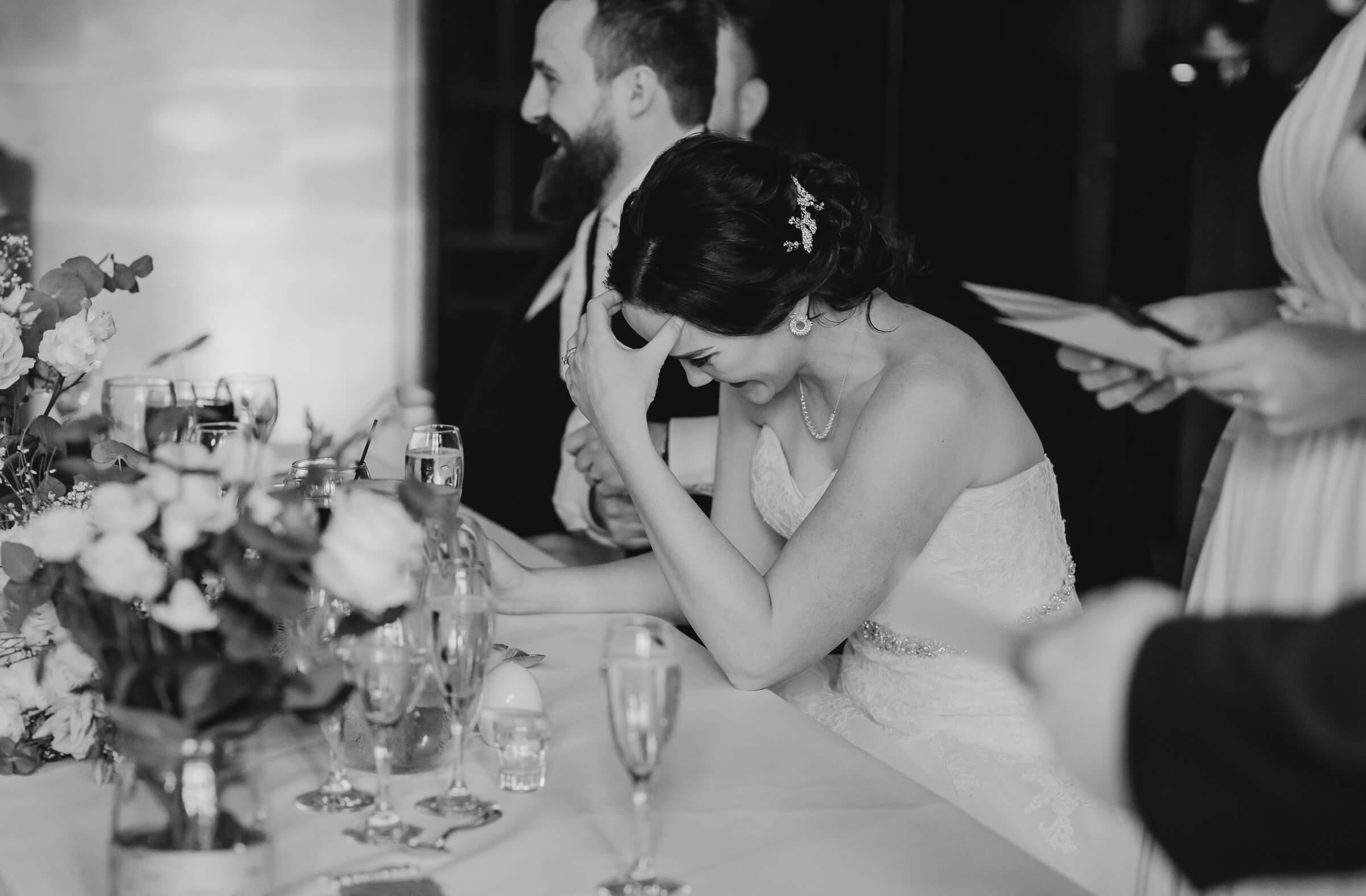 bride getting embarrassed during speech