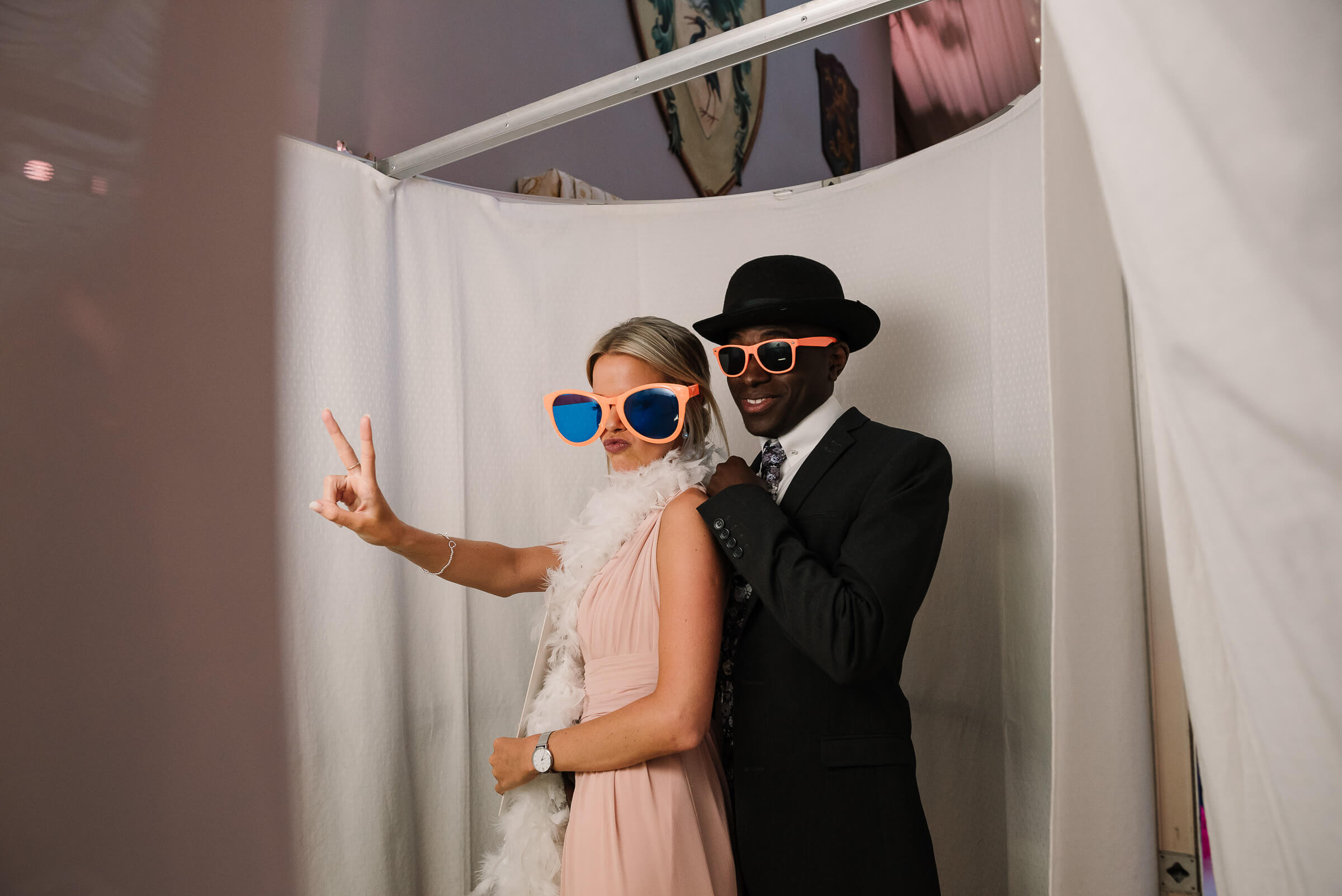 guests wearing costumes in photobooth