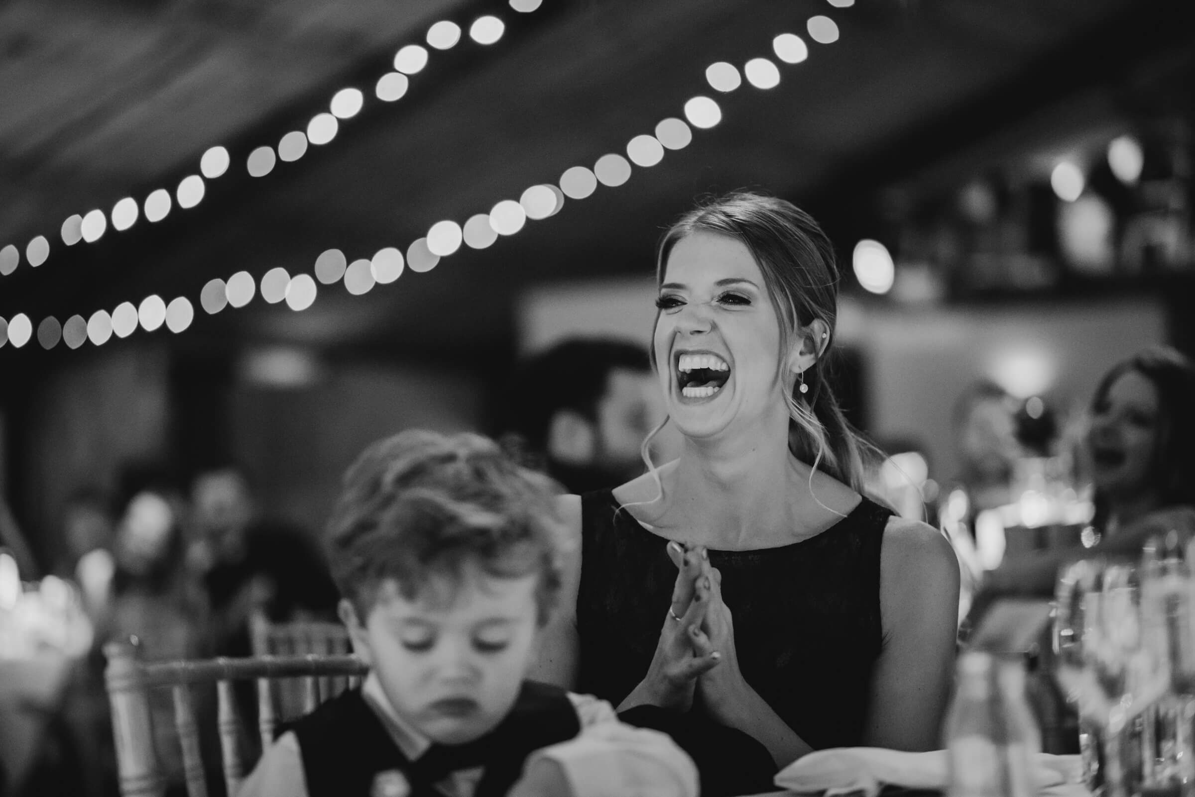 bridesmaid clapping during speeches