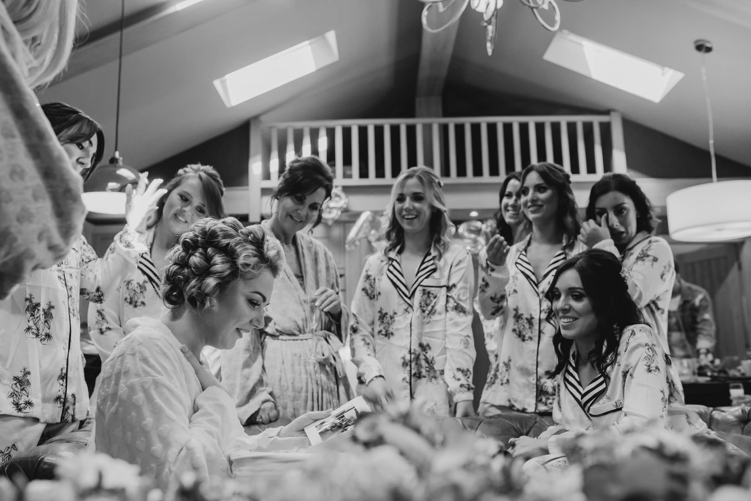 bride surrounded by friends while opening gifts