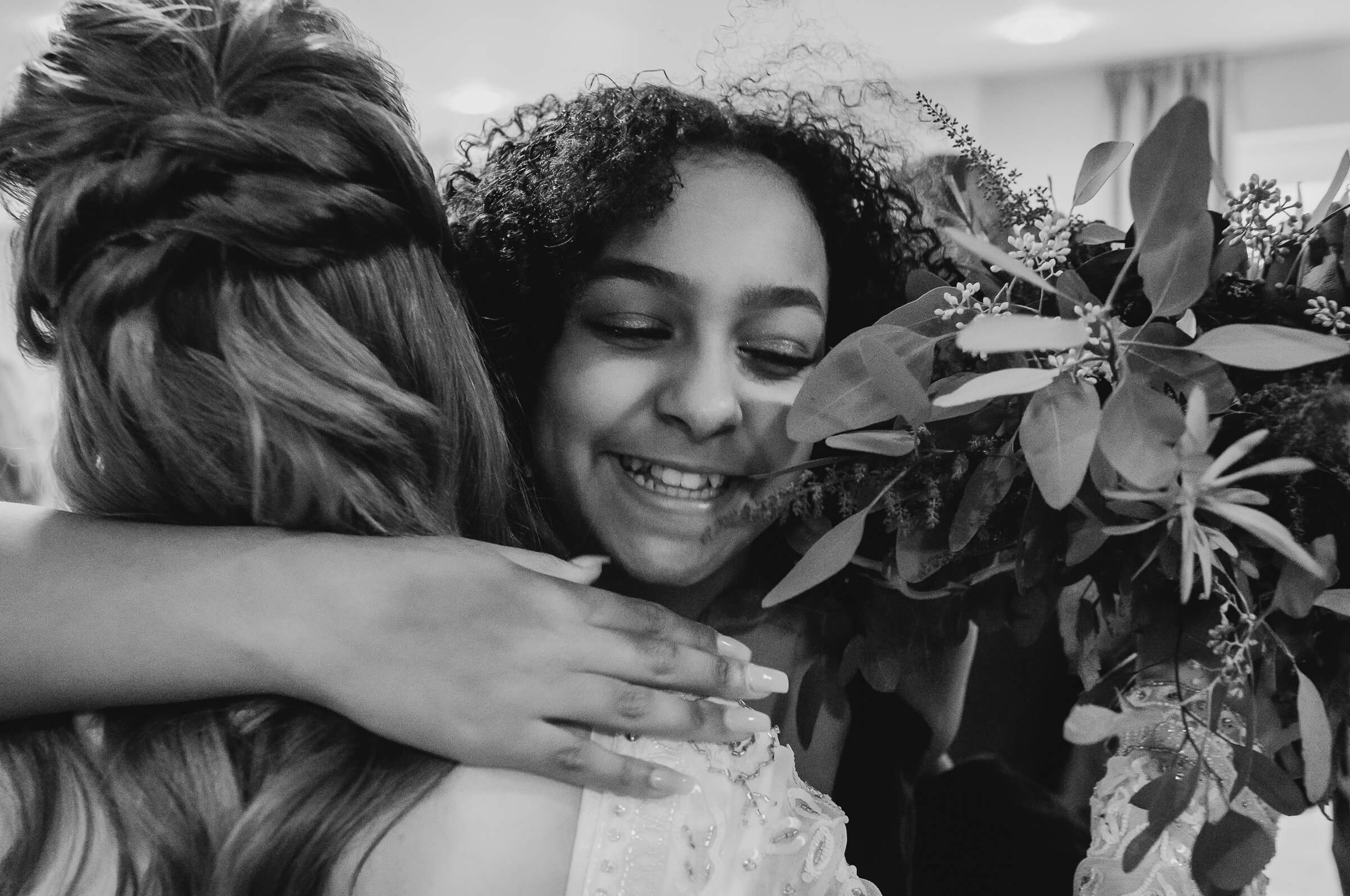 Young girl hugging bride