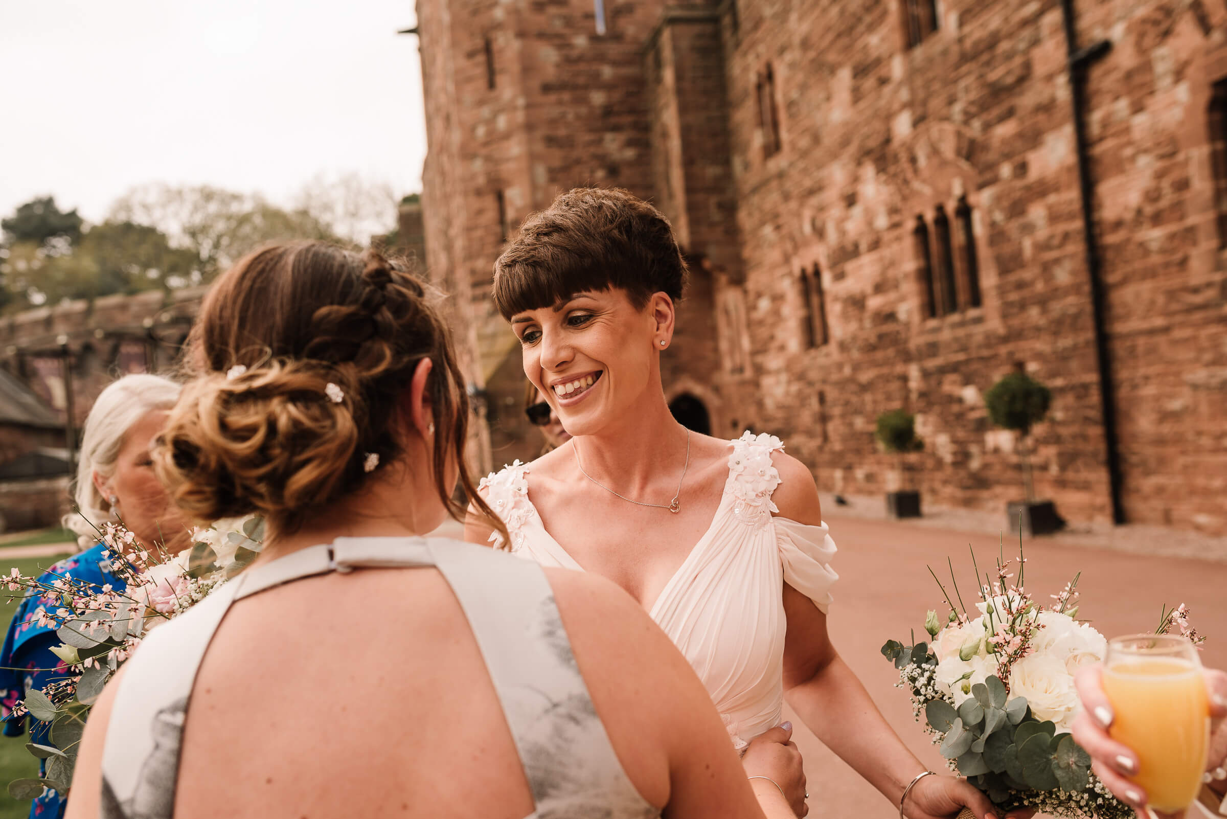 brides sister and bridemaid smiling