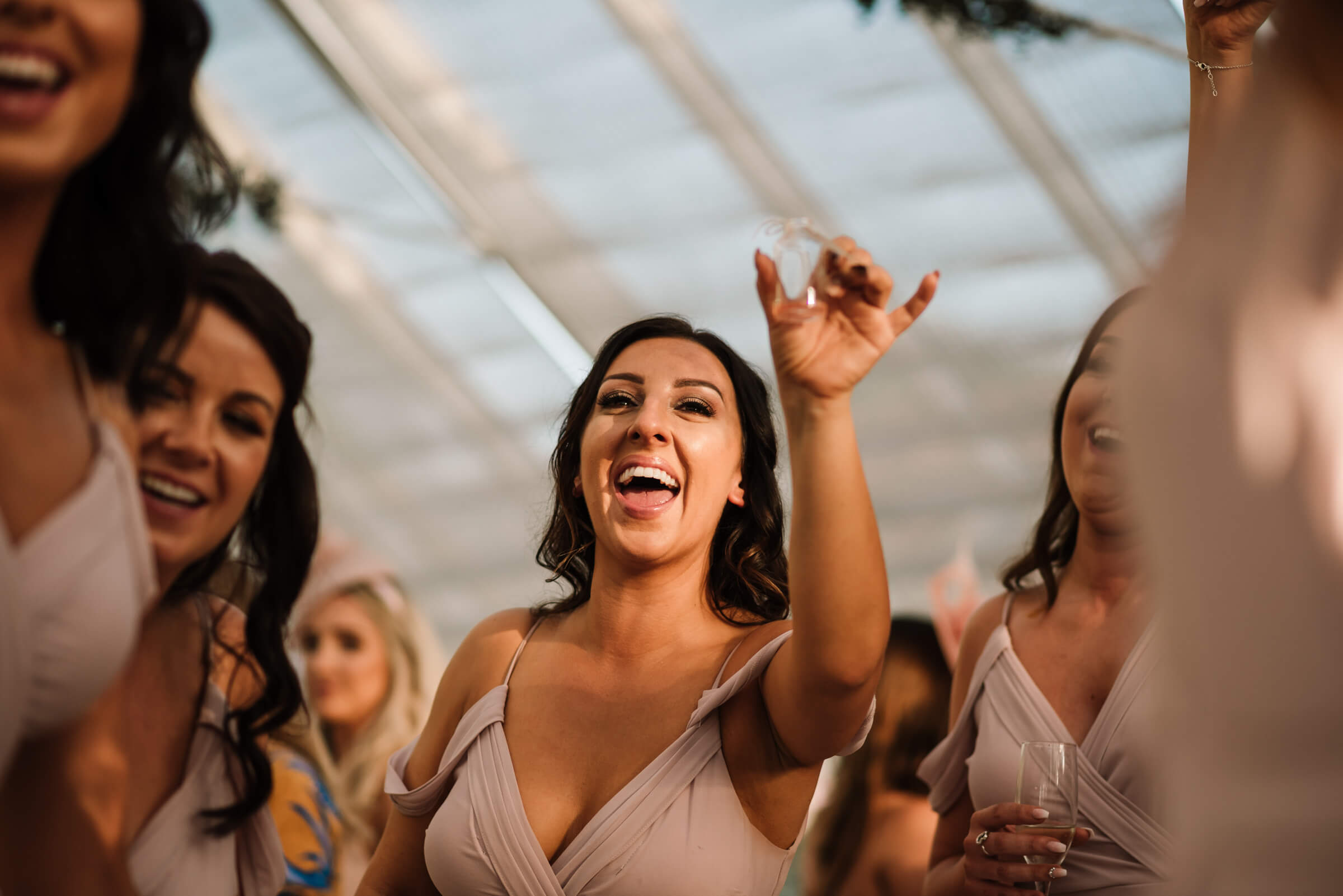 bridesmaid laughing and holding shot